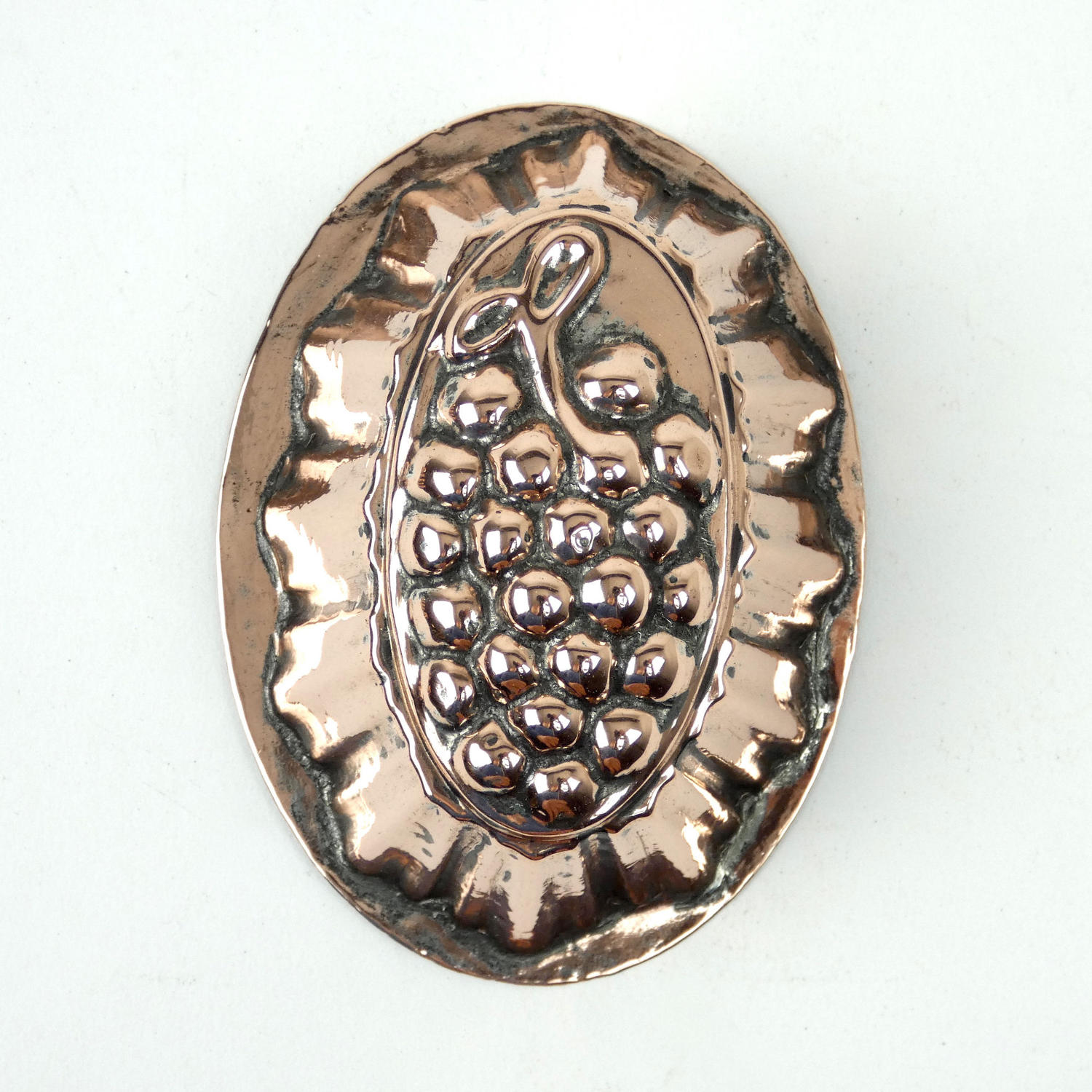 Miniature copper grape mould