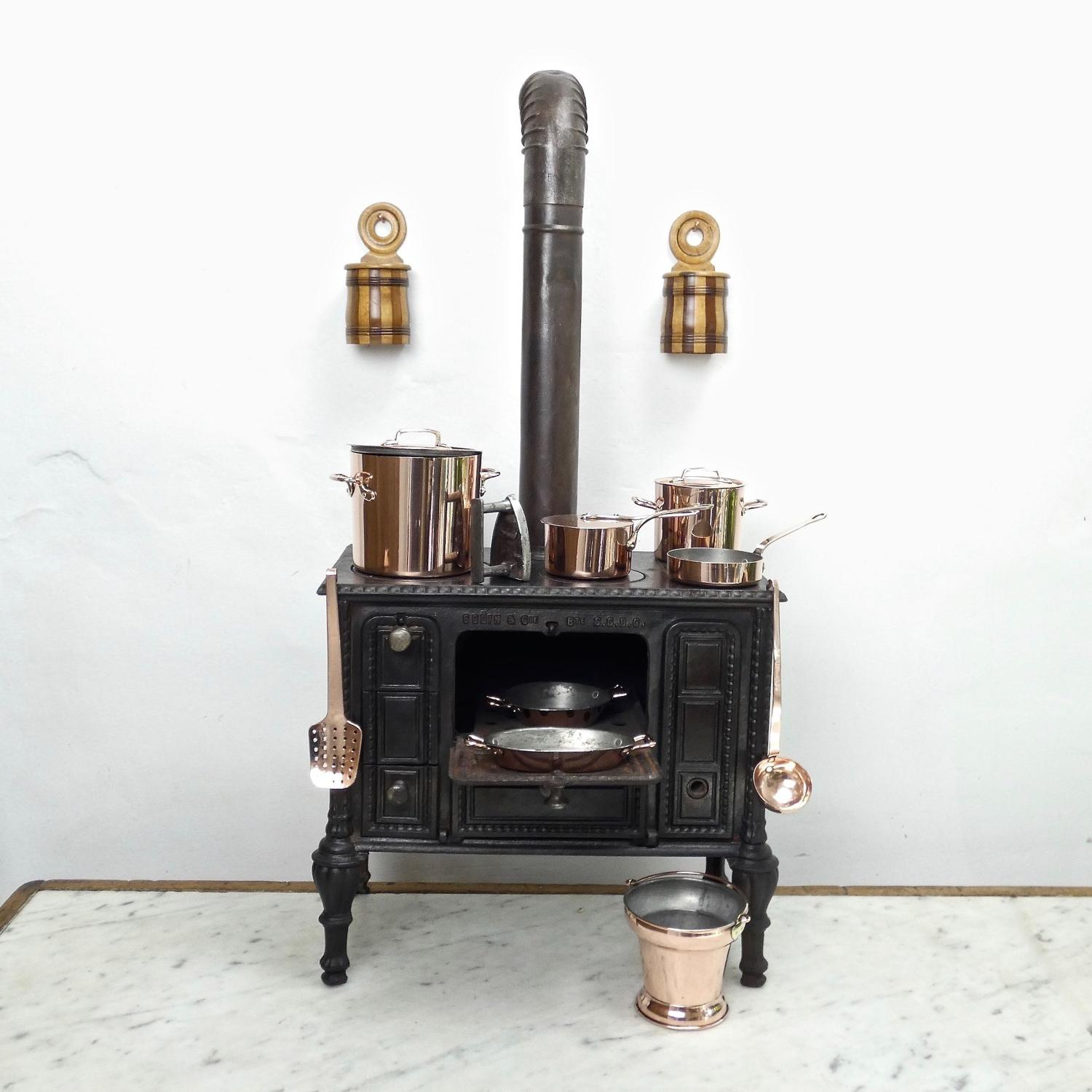 Miniature cast iron stove and copperware