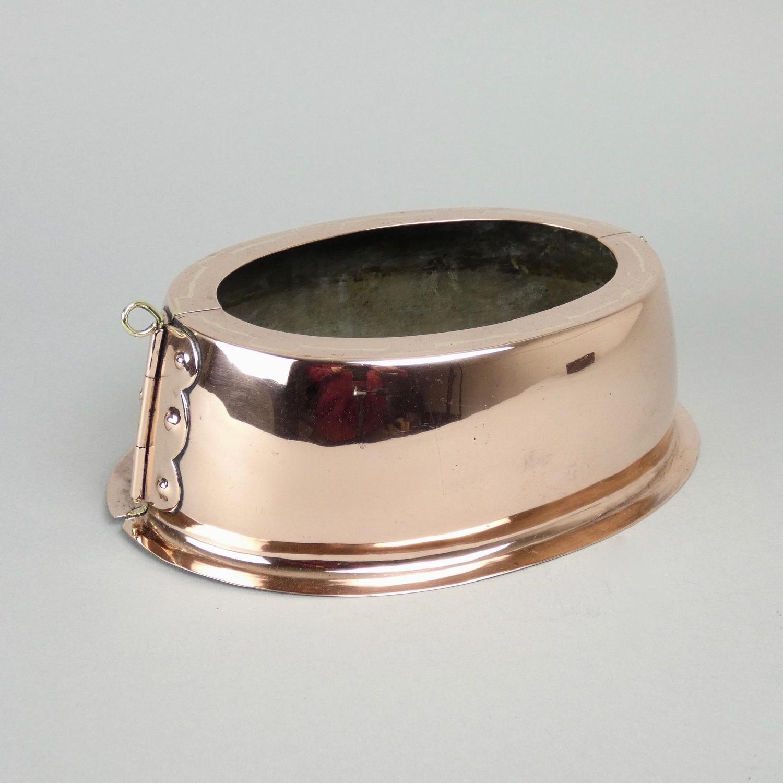 Unusual copper pie mould