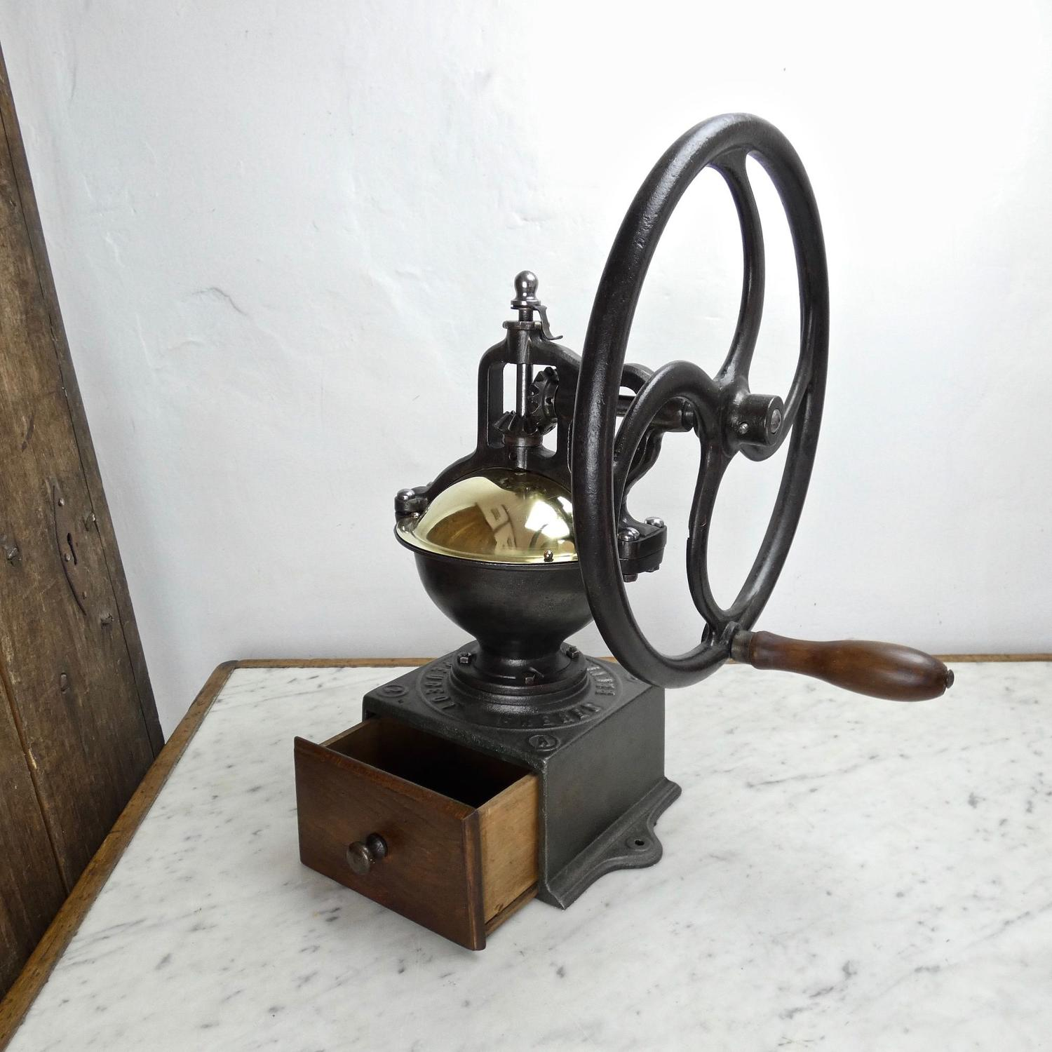Peugeot coffee mill with wheel.