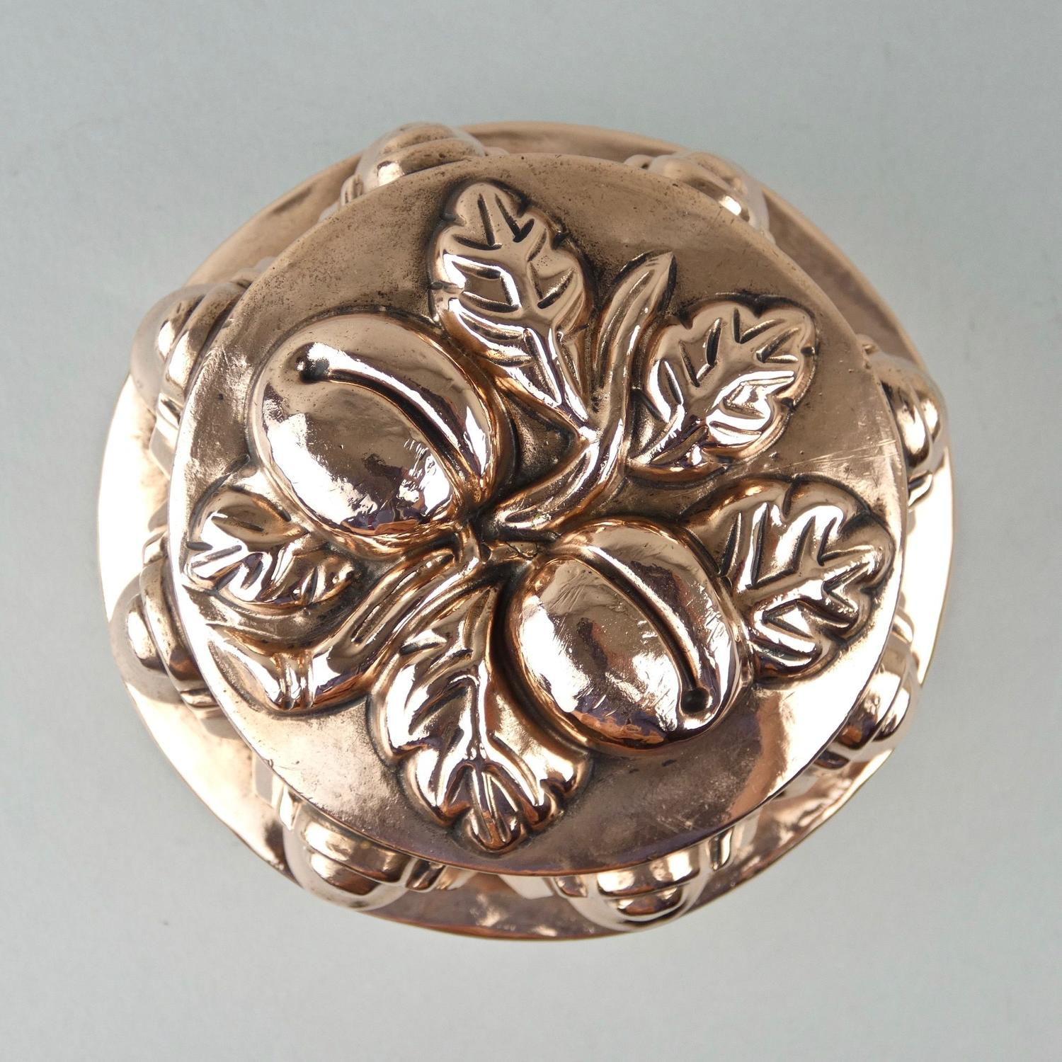 Copper mould with plums.