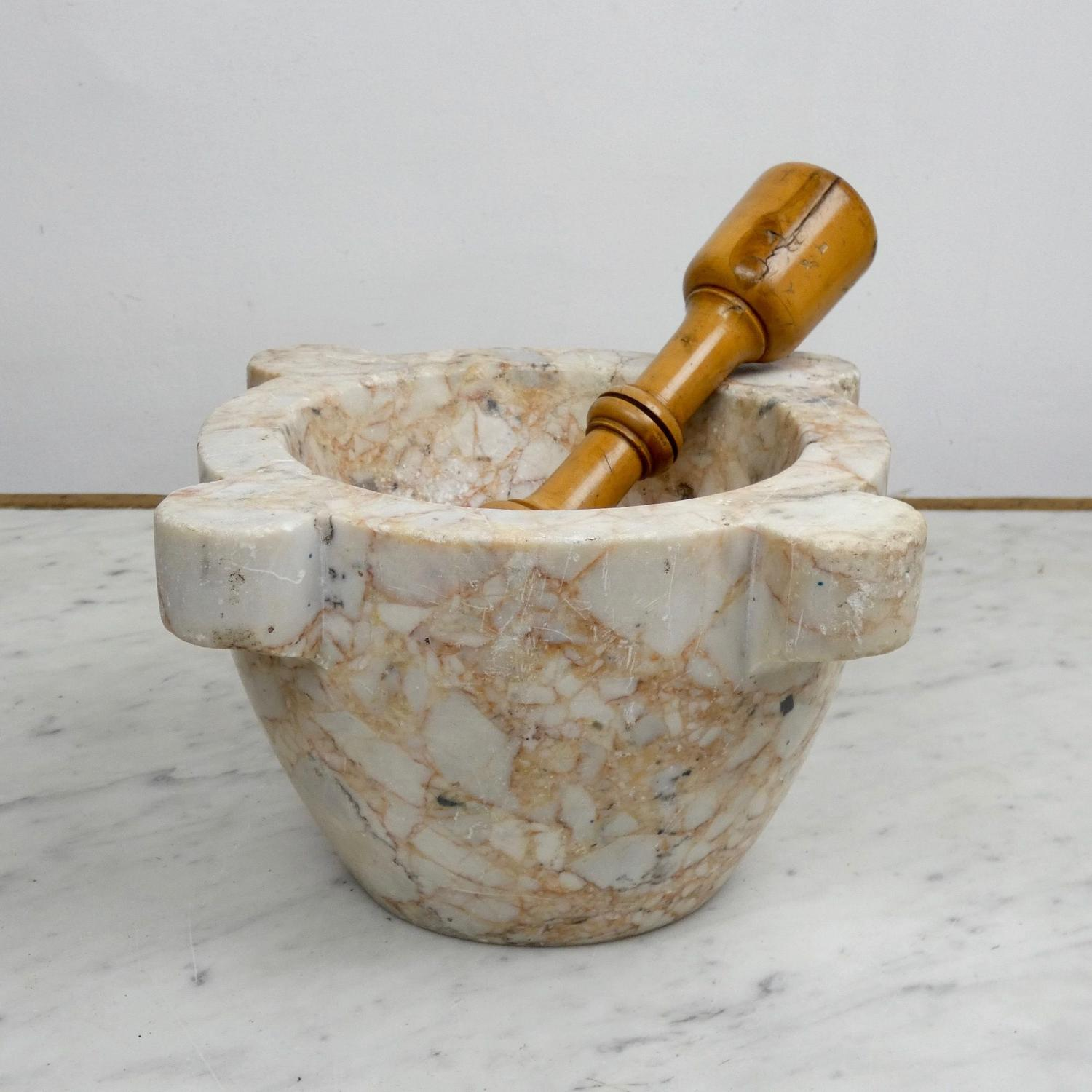 Salmon coloured marble mortar