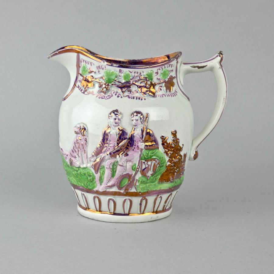 Lustre jug moulded with huntsmen