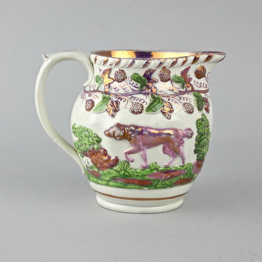 Staffordshire pink lustre jug moulded with dogs