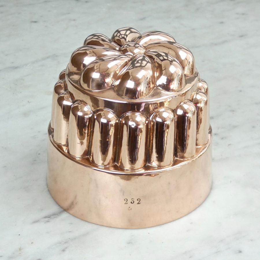 Copper mould with stylised flower top