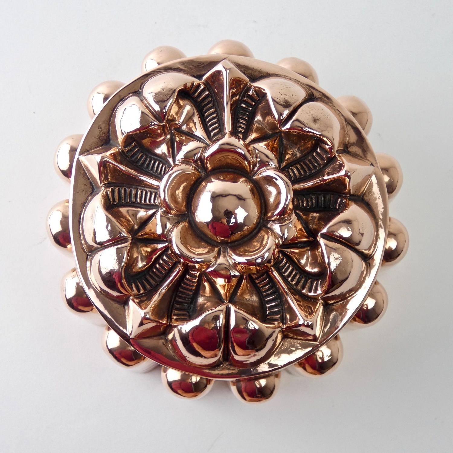 Copper mould with intricate flower top