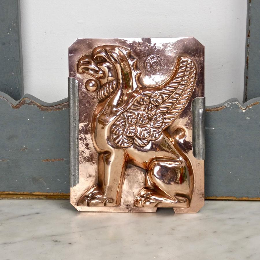 Two part copper mould of a griffin
