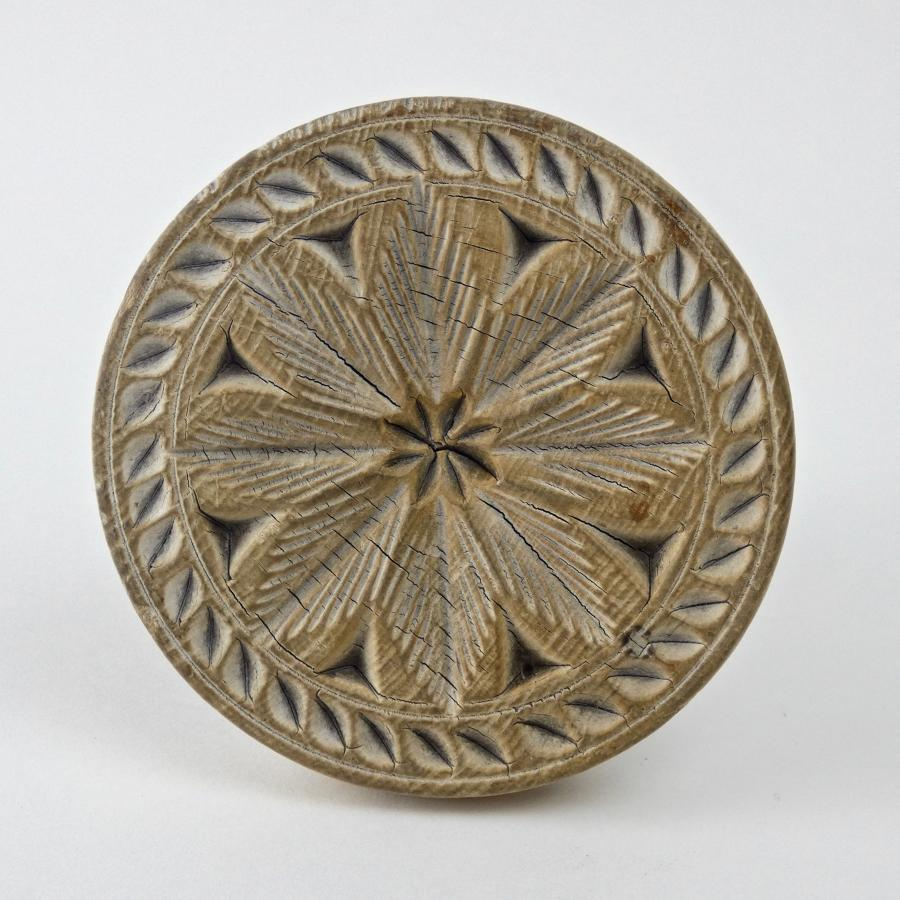 Sycamore butter print carved with a flower