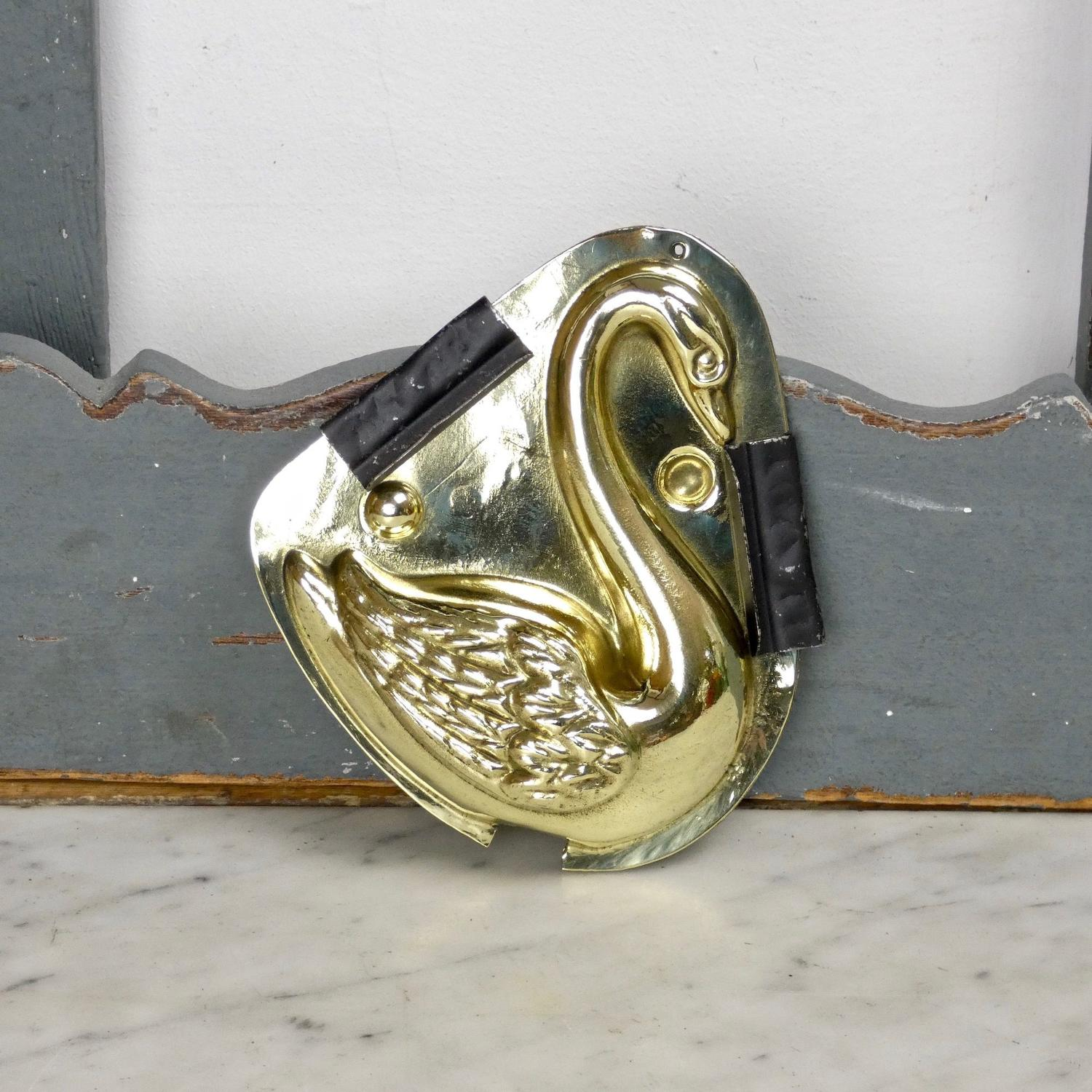 Brass nougat mould of a swan