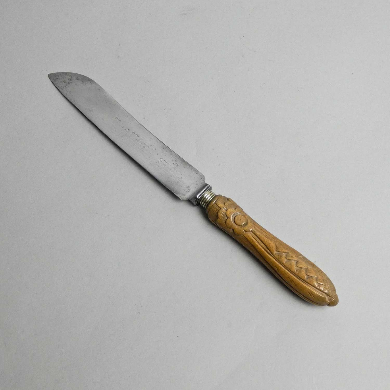 Bread knife carved with a flower.
