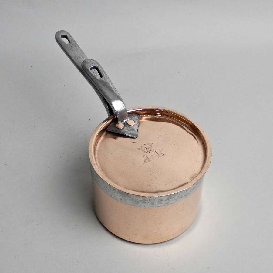 Small, engraved copper saucepan