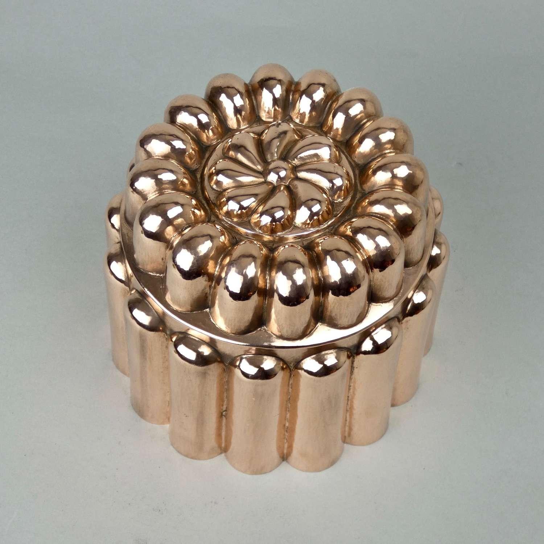 Large, ornate, copper mould.