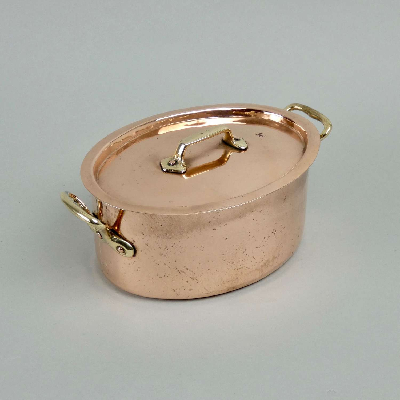Very small, oval copper casserole