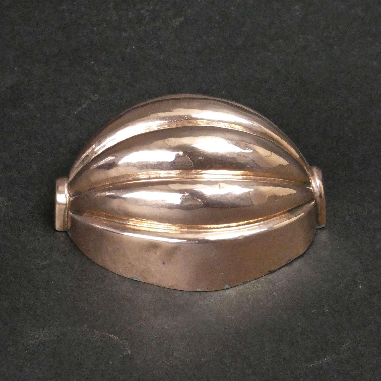 Small, copper melon mould