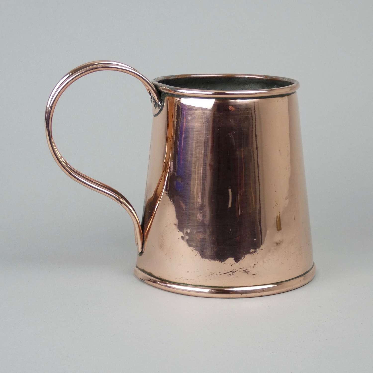Copper tankard.