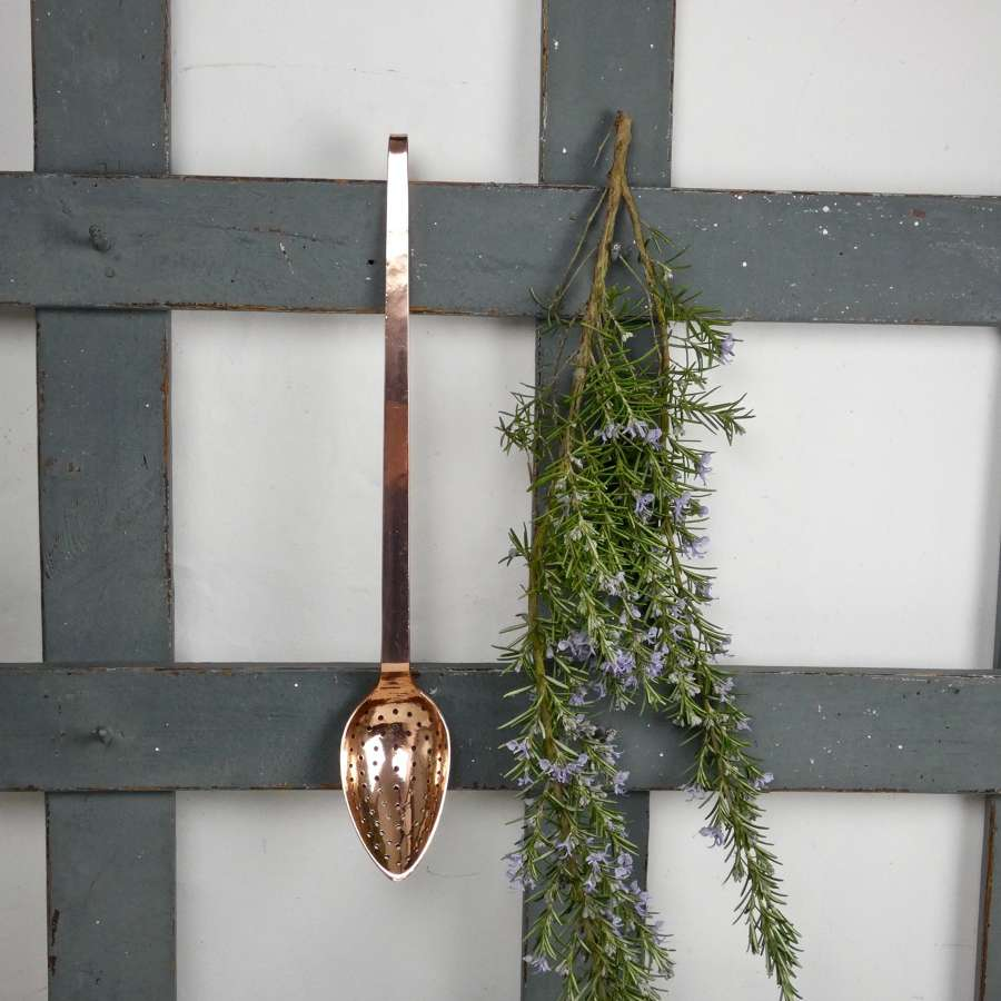 Long, copper straining spoon