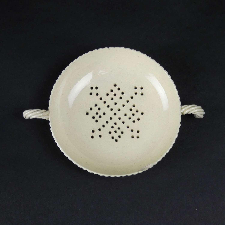 Creamware tea strainer