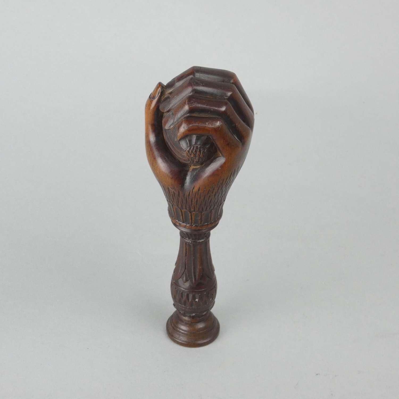 Treen nutcracker, carved with 'RIGI'.