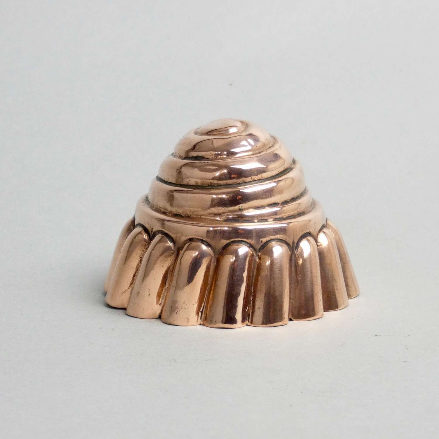 Small, spiral form copper mould.