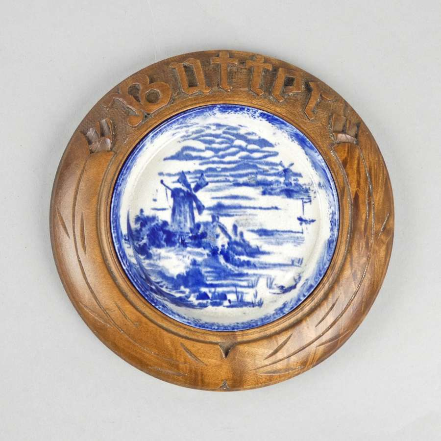 Blue printed butter dish with carved surround