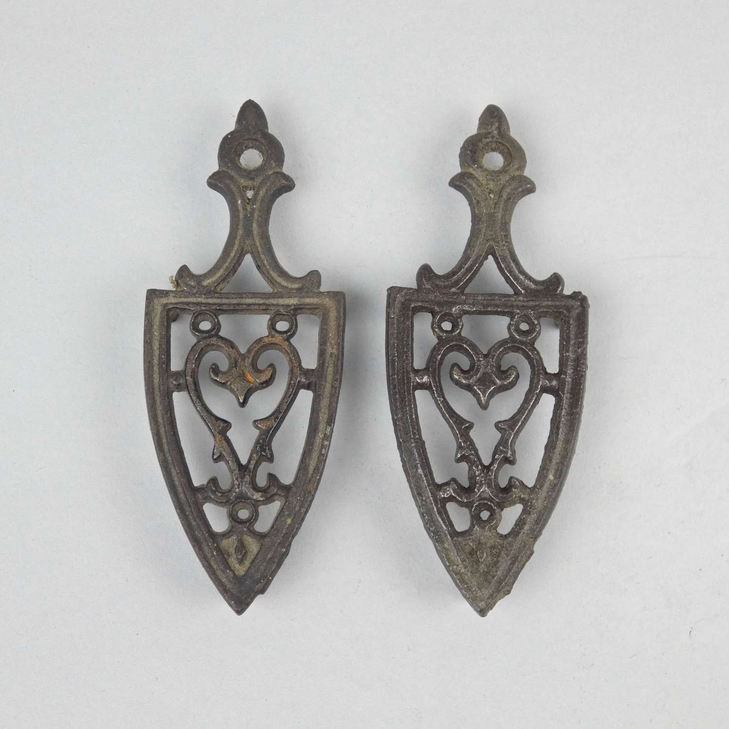 Miniature cast iron, heart design, trivets.