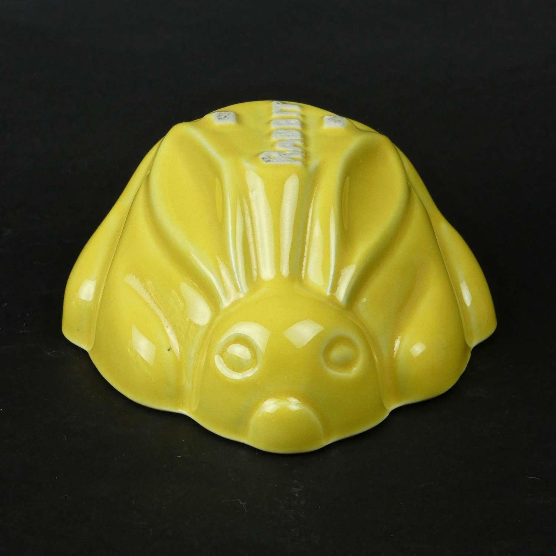 Yellow glazed rabbit mould