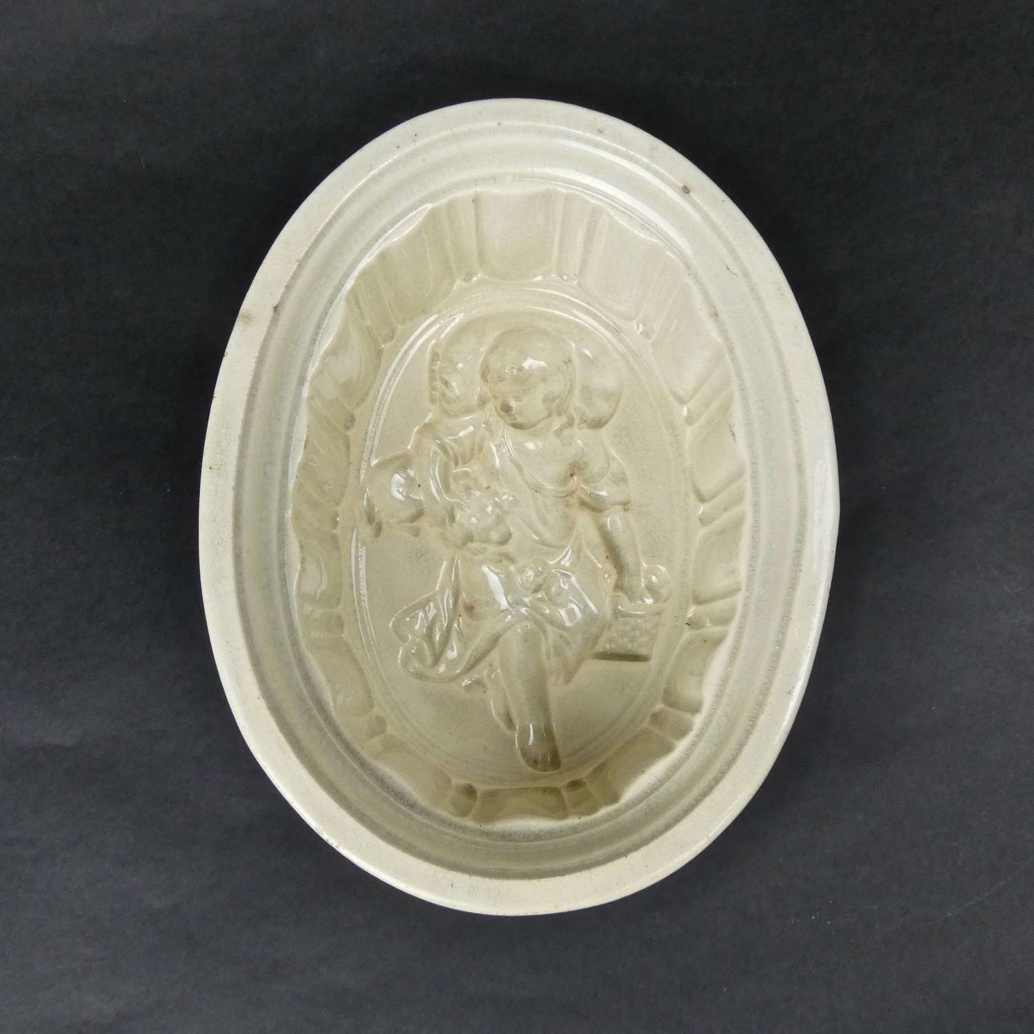 Rare, ceramic mould with child and dog.