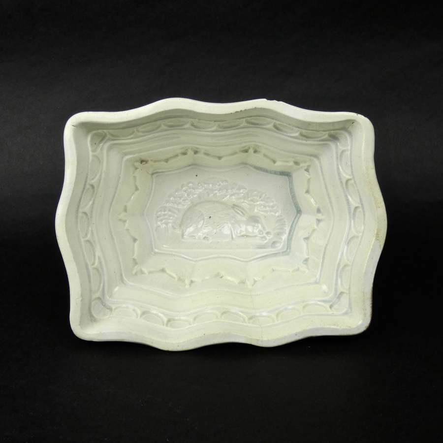 Earthenware mould with rabbit in base