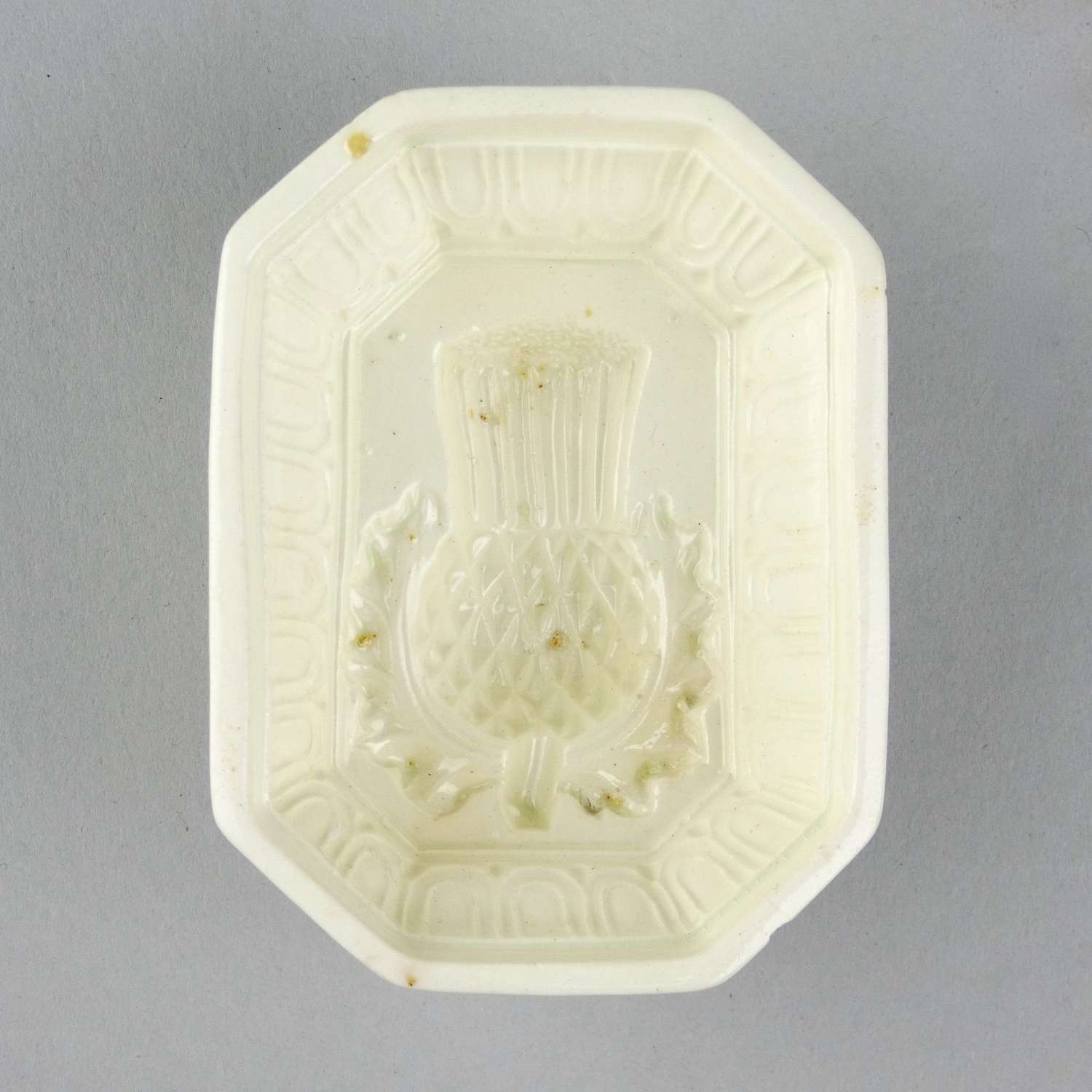 Creamware mould with thistle to base