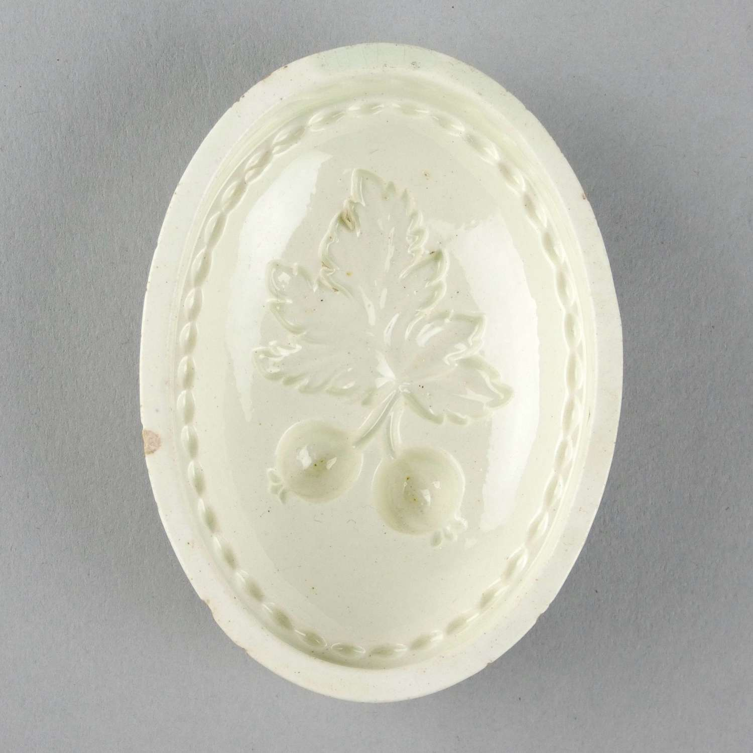 Creamware mould depicting currants