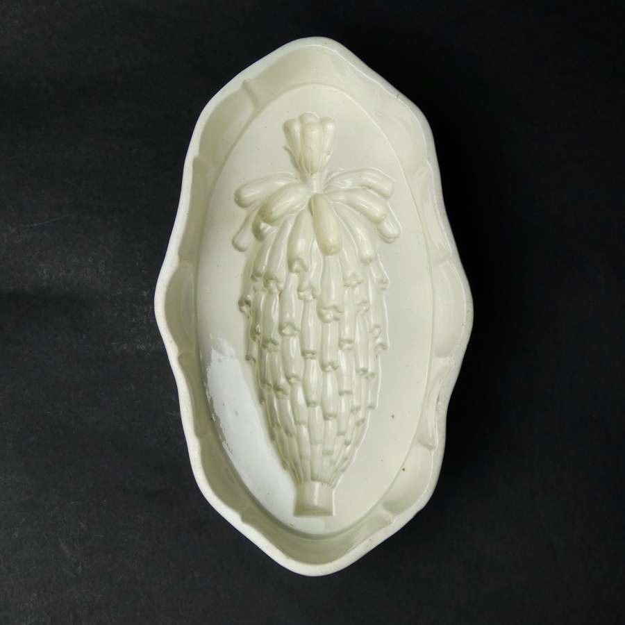 Wedgwood mould of exotic fruit