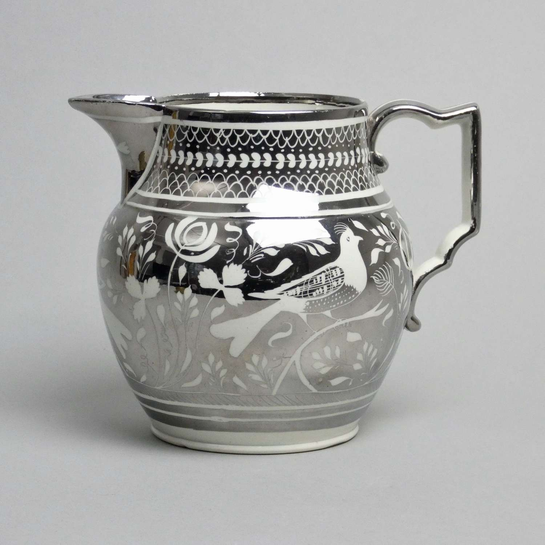 Silver resist lustre jug with birds