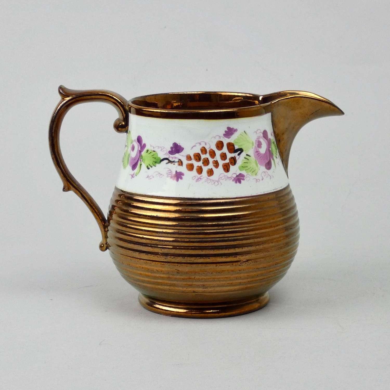 Engine turned, copper lustre jug