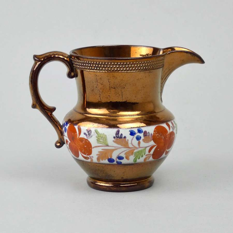Lustre jug with polychrome decoration