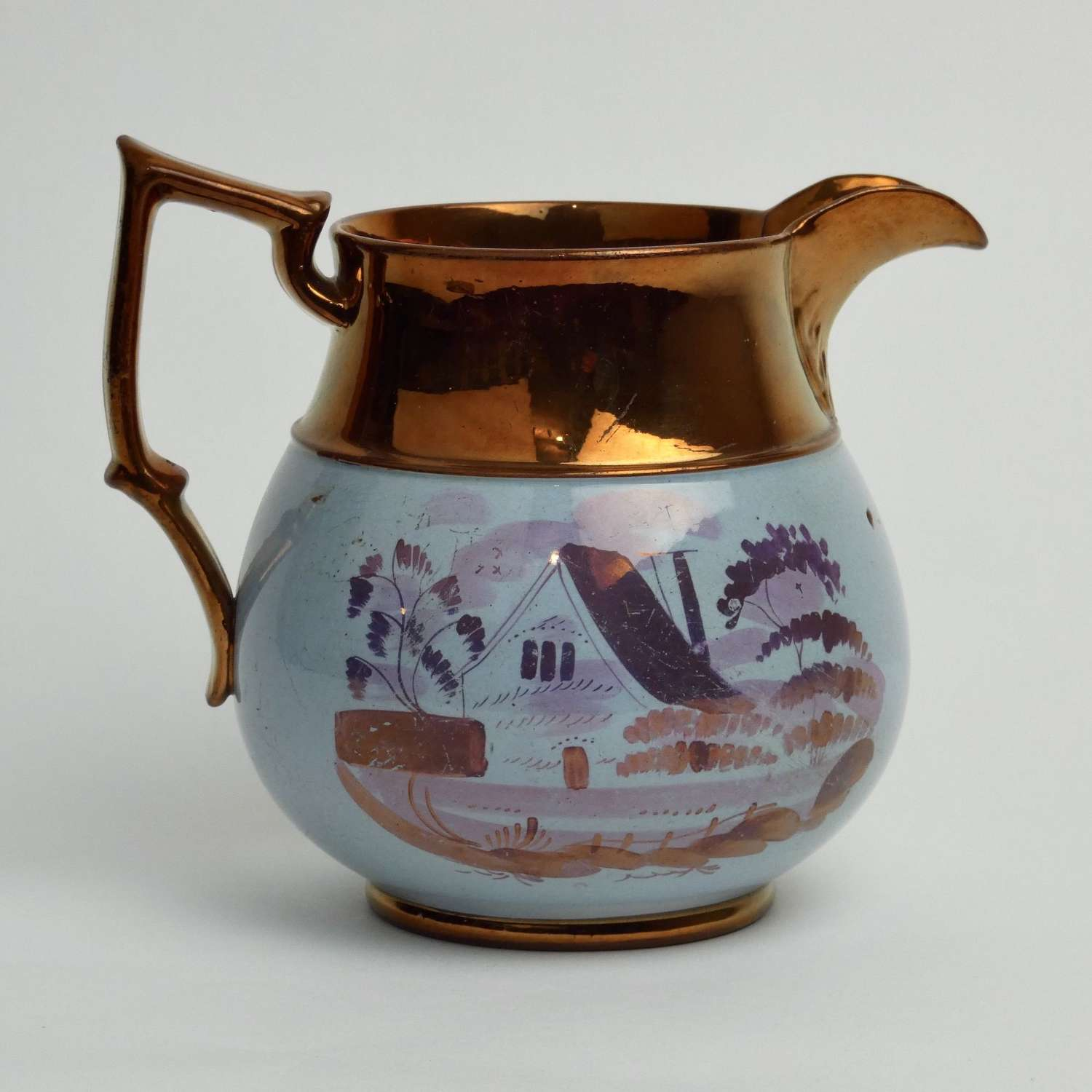 Copper lustre jug with house decoration