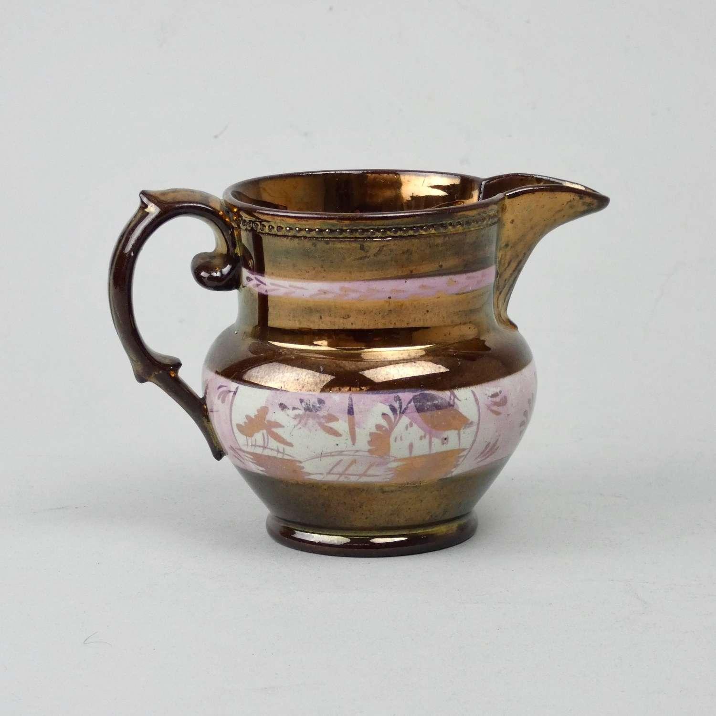 Small copper lustre jug