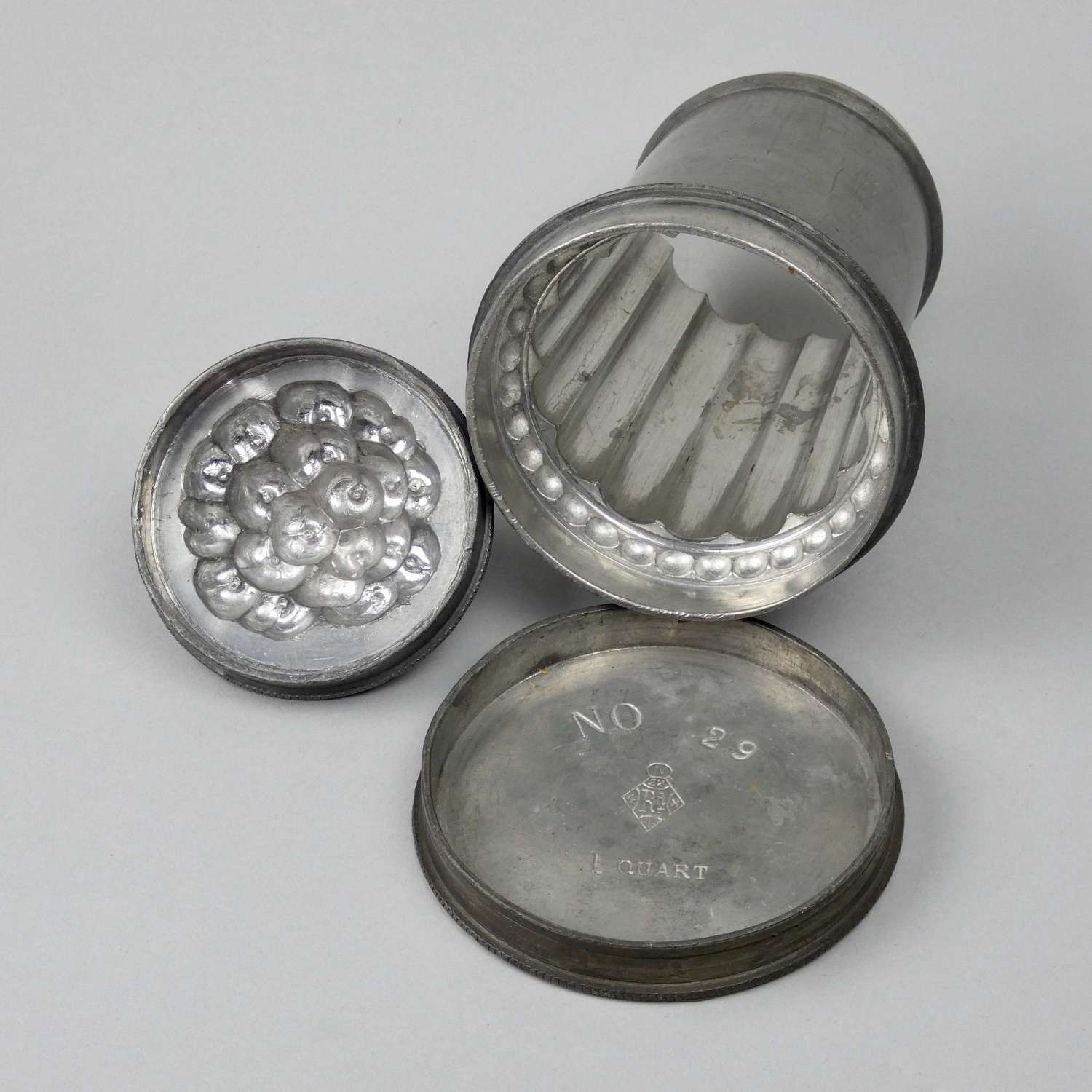 Pewter banquet mould with berries