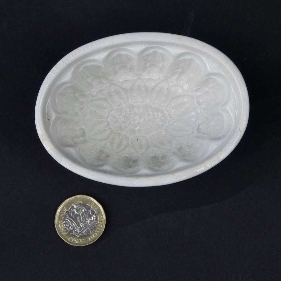 Small ironstone sunflower mould