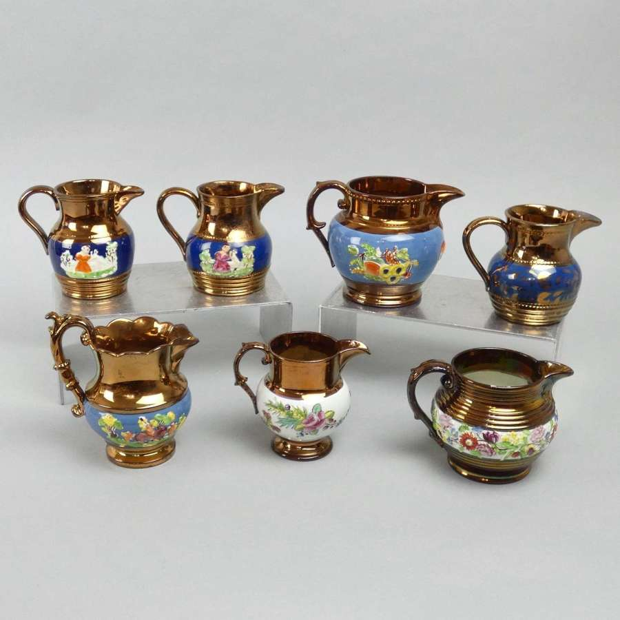 Collection of copper lustre jugs