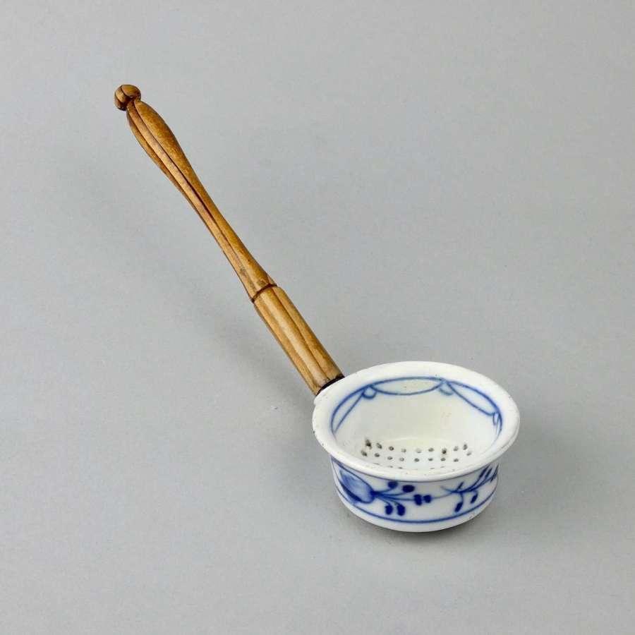Pierced, porcelain ladle
