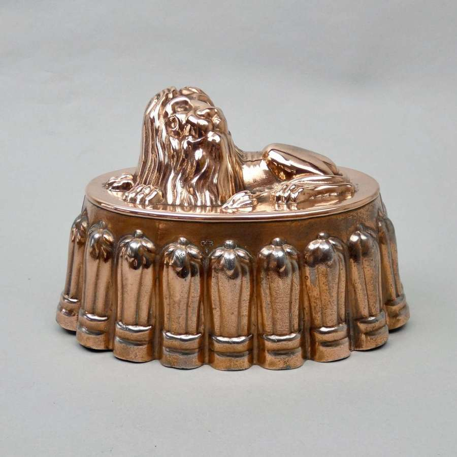 Tin mould with copper lion top