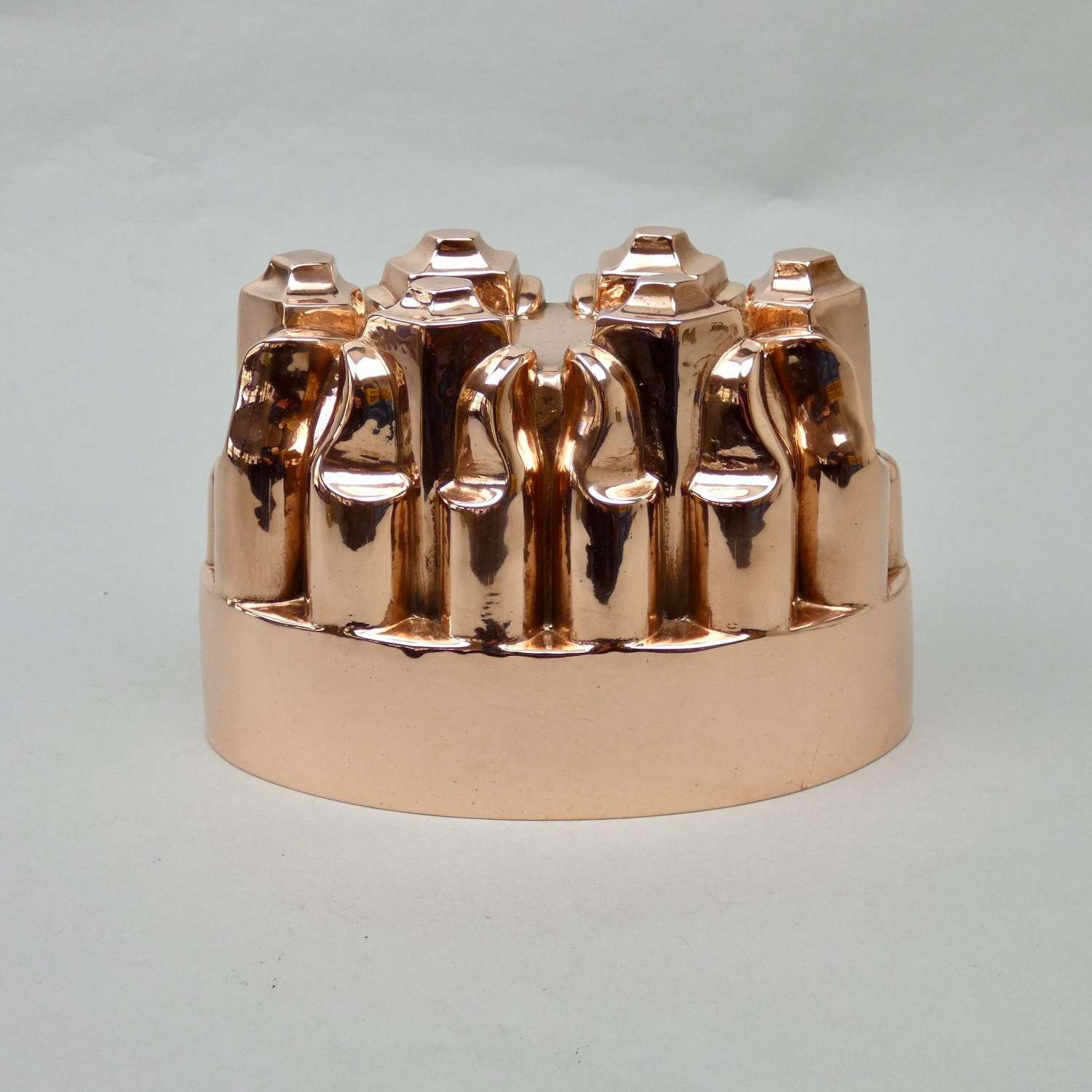 Oval copper mould with scrolls & columns