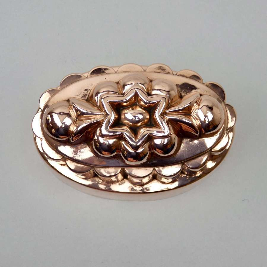Oval copper mould with central star