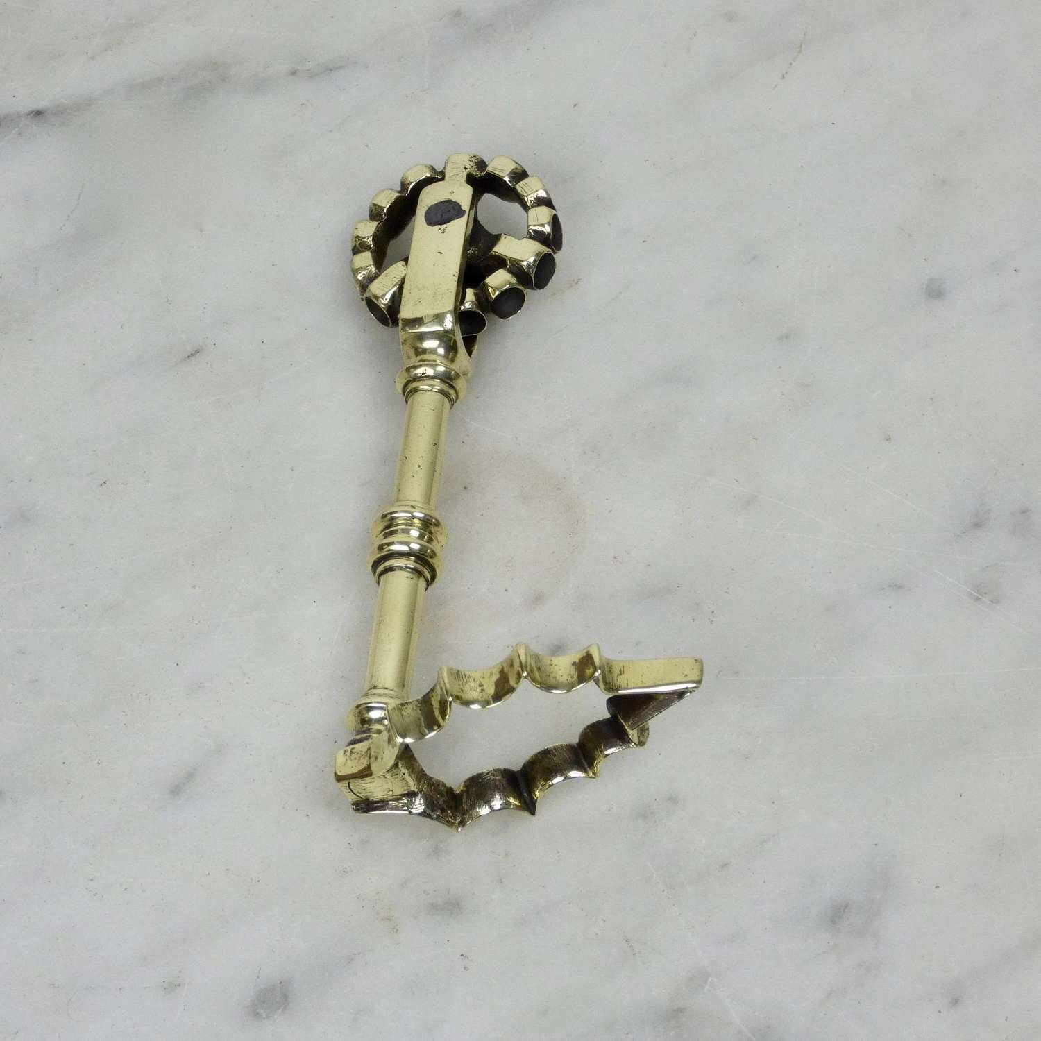 Brass pastry tool with unusual wheel
