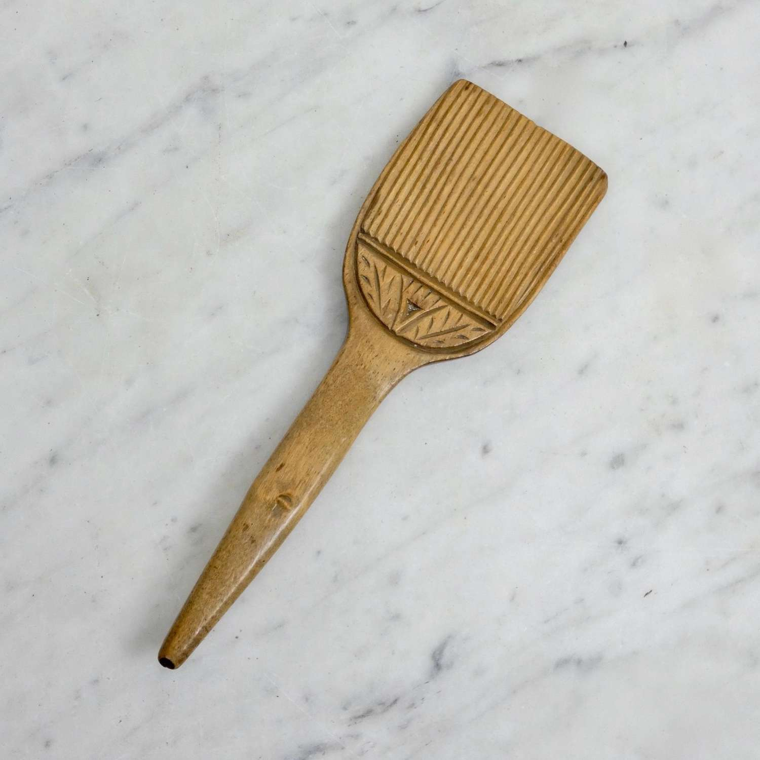 Carved sycamore butter curler