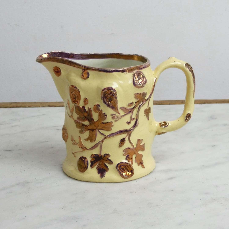Moulded pink lustre jug