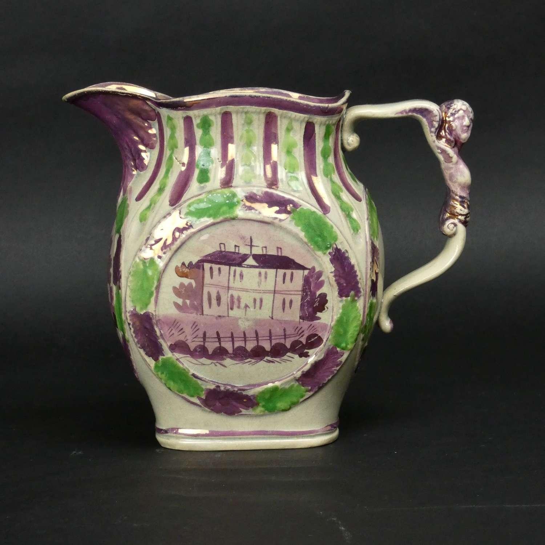 Pink lustre jug with moulded human figure handle