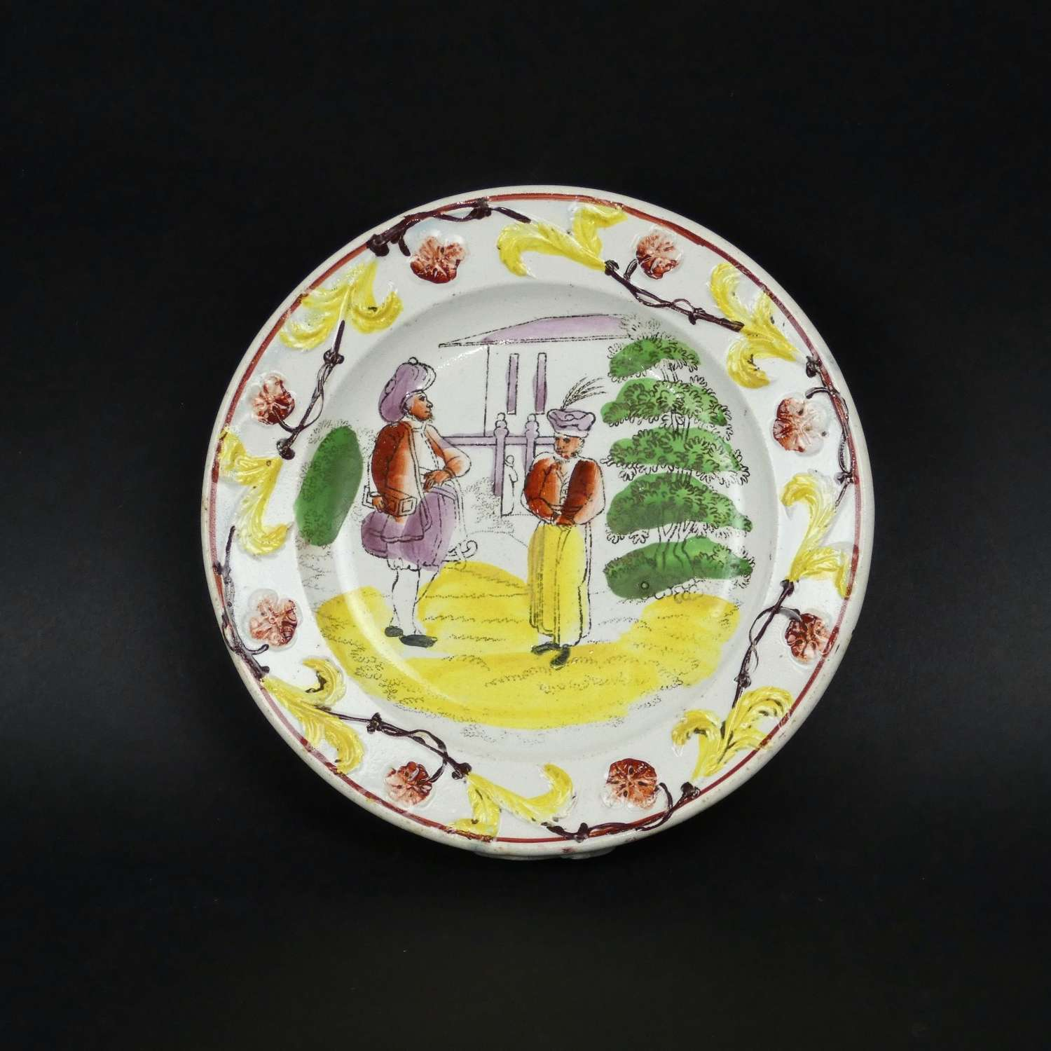 Child's plate with colourful, oriental gentlemen