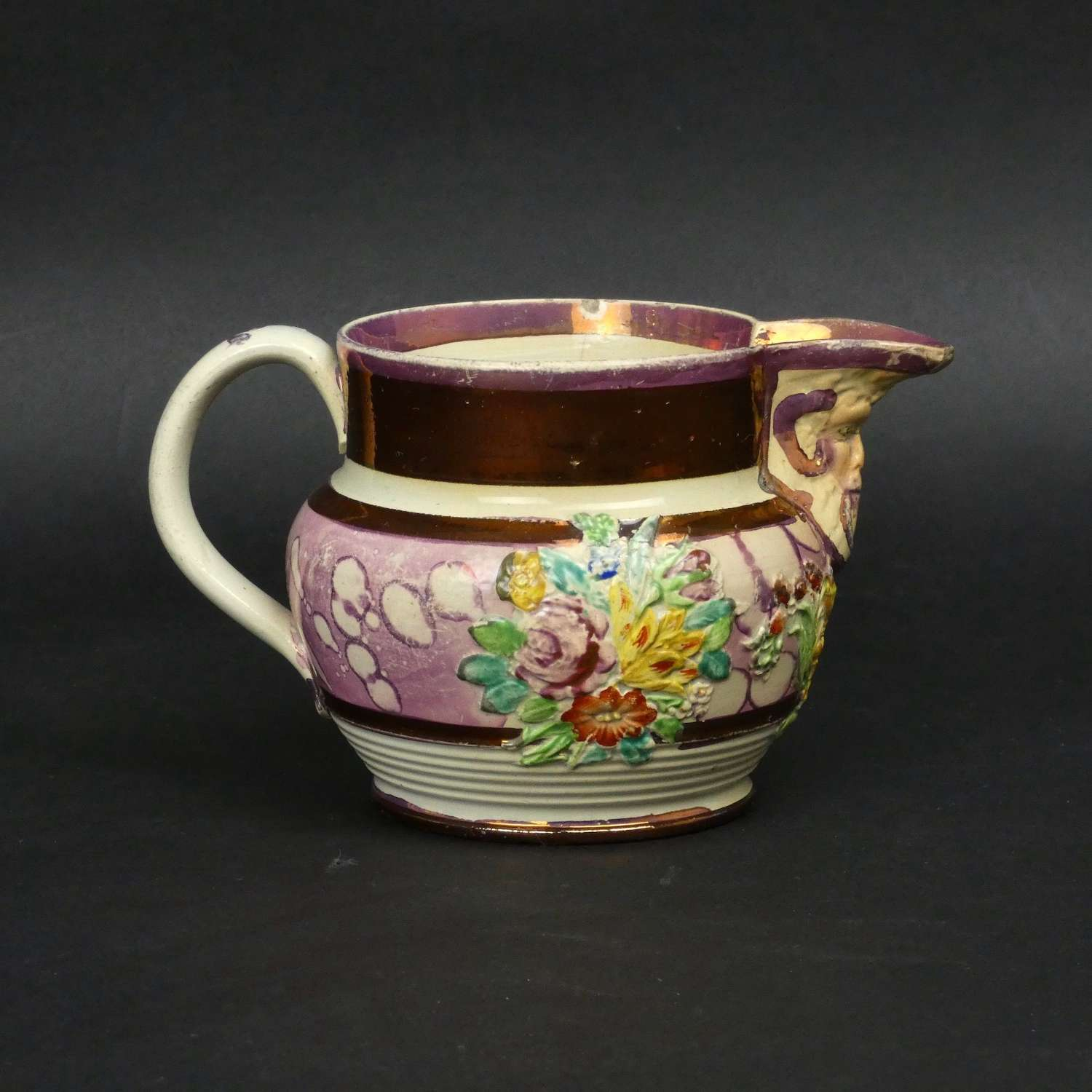 Small, pink lustre jug with moulded decoration