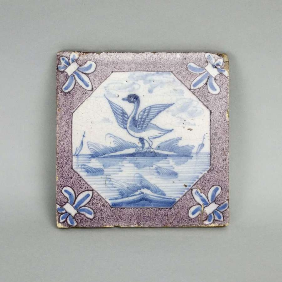 Delft tile painted with a swan